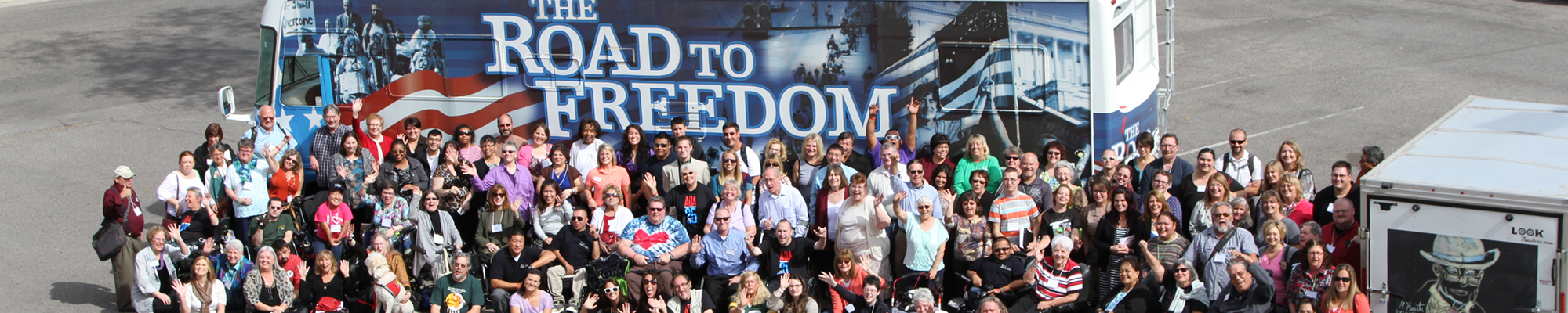 Image of a crowd of people in front of the Road to Freedom bus.