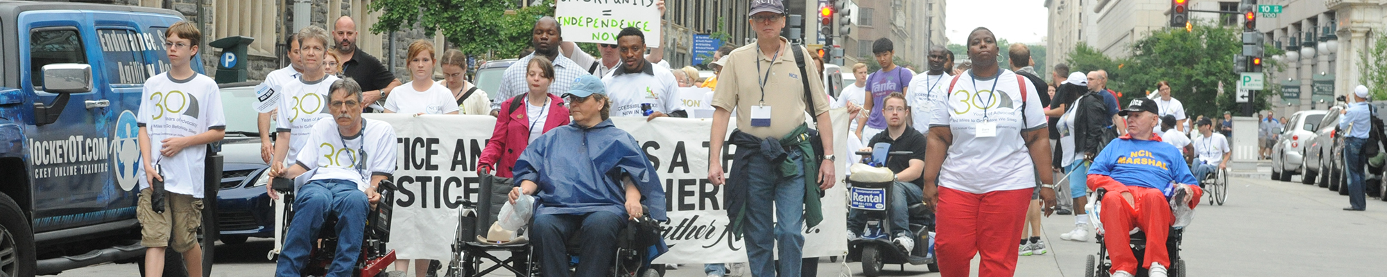 Image of people marching in the ADA 25 parade.