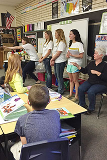 Photo of McPherson High School students spent a day presenting the children's book to elementary students and engaging them in activities to learn more about volunteerism.