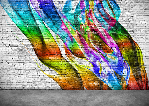Photo of colorful graffiti on a brick wall.