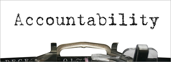 "Image of a typewriter carriage with the word ""Accountability"" typed onto a piece of paper."