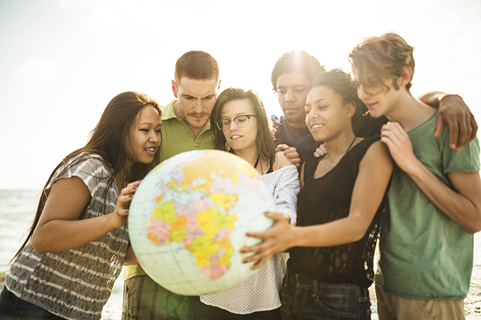 Photo of young people holding a globe
