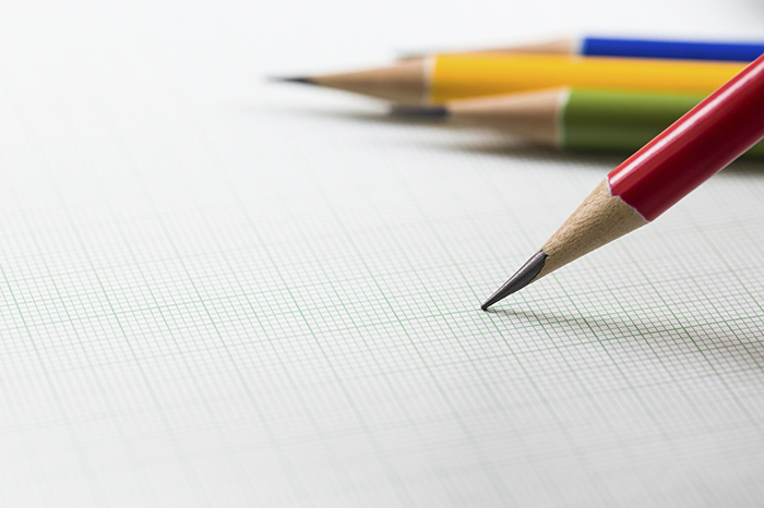 Photo of multicolored pencils on graph paper