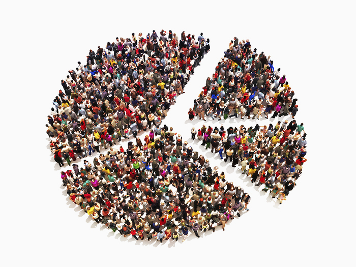 Photo of people standing in a peace sign shaped pie chart