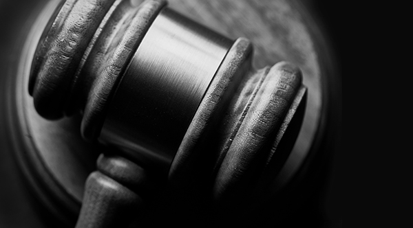 Black-and-white image of a gavel.