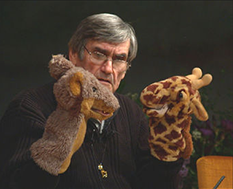 Photo of Marshall Rosenberg with animal puppets
