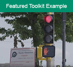 """Image of a stoplight with the text """"Featured Toolkit Example"""" above it."""