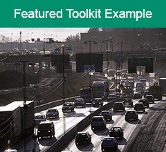 """Traffic jam on freeway with the text """"Featured Toolkit Example"""" above it."""