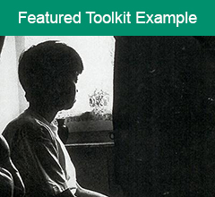 """Black and white image of woman staring out of a window with the text """"Featured Toolkit Example"""" above it."""