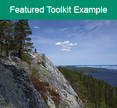 """Mountain view in Finland with the text """"Featured Toolkit Example"""" above it."""