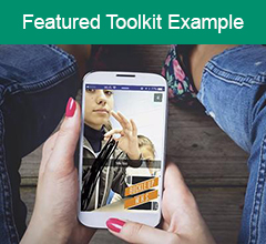 """Image of phone with video on it, with the text """"Featured Toolkit Example"""" above it."""