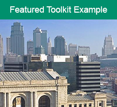 """Kansas City skyline with the words """"Featured Toolkit Example"""" above it."""