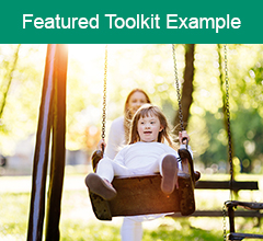 """Girl with disabilities on swing in park with the text """"Featured Toolkit Example"""" at the top."""