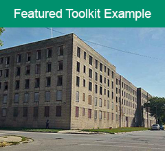 """An abandoned building in Chicago with the text """"Feature Toolkit Example"""" above it."""