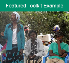 """Kenyans gathered at outdoor meeting with the text """"Featured Toolkit Example"""" at the top."""