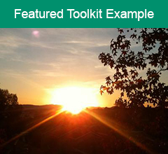 """Sunrise with the text """"Featured Toolkit Example"""" at the top."""