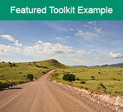"""New Mexico road and landscape with the text """"Featured Toolkit Example"""" at the top."""