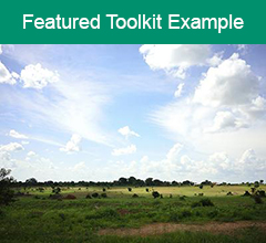 """Kenya sky and landscape with the words """"Featured Toolkit Example"""" at the top."""