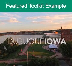 """Title card from video, featuring the city with the words Dubuque, Iowa superimposed. The text """"Featured Toolkit Example"""" is at the top."""