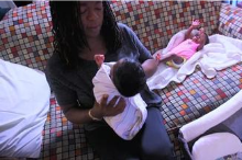 Mother holding newborn baby.