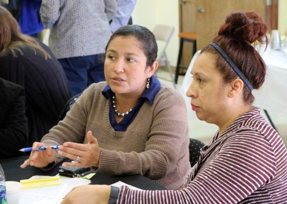 KU CCHD Community Mobilizer Monica Mendez engages in discussion with community stakeholders around community health priorities in a collaborative planning meeting in Wyandotte County.