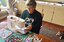 Image of woman sewing masks