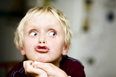 Image of boy rolling his eyes to the right