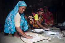 Thumbnail of three women making roti.