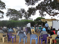 Photo of attendees gathered for the Community Dialogue Day in Komo, Kenya.
