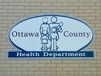 Photo of Ottawa County Health Department building sign.