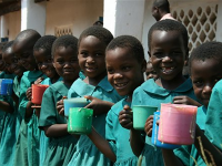 Photo of a group of young schoolgirls enjoying Mary's meals.