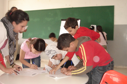 Image of teacher with students in classroom.